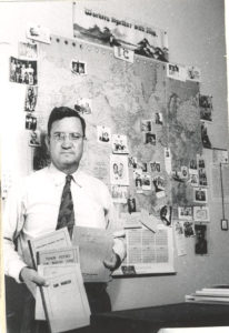 Homer Duncan with map and books